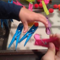 playing-with-pegs-and-pompoms